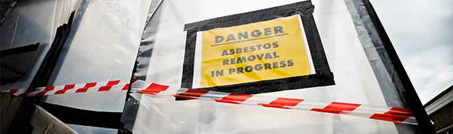 danger asbestos removal yellow sign with caution tape RDS Environmental Colorado